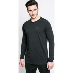 Nike Sportswear - Longsleeve. Czarne bluzki z długim rękawem męskie Nike Sportswear, z aplikacjami, z bawełny, z okrągłym kołnierzem. W wyprzedaży za 129.90 zł.