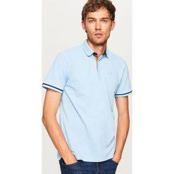 Koszulka polo - Niebieski. Koszulki polo męskie marki INESIS. W wyprzedaży za 59.99 zł.