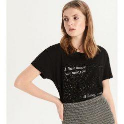 T-shirt z brokatową aplikacją - Czarny. T-shirty damskie marki DOMYOS. W wyprzedaży za 9.99 zł.