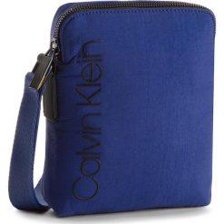 Saszetka CALVIN KLEIN - Strapped Mini Reporter K50K503777  447. Niebieskie saszetki męskie Calvin Klein, z materiału, młodzieżowe. W wyprzedaży za 229.00 zł.