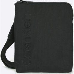 Calvin Klein - Saszetka. Czarne saszetki męskie Calvin Klein, z materiału, casualowe. Za 299.90 zł.