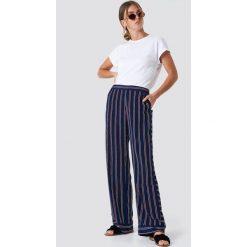 Rut&Circle Spodnie w paski Vega - Blue. Niebieskie spodnie materiałowe damskie Rut&Circle, w paski, z poliesteru. Za 161.95 zł.
