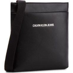 Saszetka CALVIN KLEIN JEANS - Smooth Essential Mic K40K400603  001. Czarne saszetki męskie Calvin Klein Jeans, z jeansu, młodzieżowe. Za 299.00 zł.