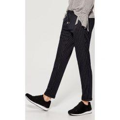 Luźne spodnie z elastyczną talią - Niebieski. Spodnie materiałowe damskie marki DOMYOS. W wyprzedaży za 49.99 zł.