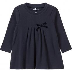 """Tunika """"Frista"""" w kolorze granatowym. Niebieskie bluzki dla dziewczynek Name it Baby, z bawełny, z kokardą. W wyprzedaży za 42.95 zł."""