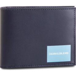 Duży Portfel Męski CALVIN KLEIN JEANS - Coated Canvas Billfold W Coin K40K400836 449. Niebieskie portfele męskie Calvin Klein Jeans, z jeansu. Za 279.00 zł.