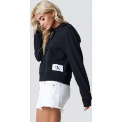 Calvin Klein Bluza z kapturem Harrisom True Icon - Black. Czarne bluzy damskie Calvin Klein, z aplikacjami, z dzianiny. Za 404.95 zł.