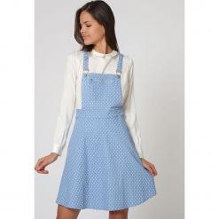 """Sukienka """"Ogrodniczki"""" w kolorze jasnoniebieskim. Niebieskie sukienki damskie TrakaBarraka, w kropki. W wyprzedaży za 119.95 zł."""