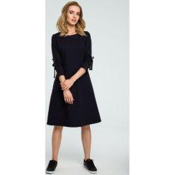Sukienka z wiązanymi lampasami moe388. Niebieskie sukienki dla dziewczynek MOE, eleganckie. Za 139.00 zł.