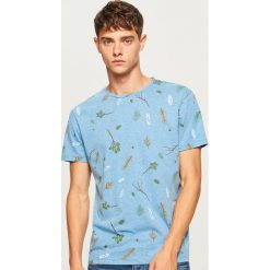 T-shirt z nadrukiem - Niebieski. T-shirty damskie marki DOMYOS. W wyprzedaży za 29.99 zł.