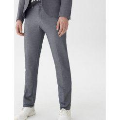 Spodnie garniturowe slim fit - Szary. Szare eleganckie spodnie męskie House. Za 129.99 zł.