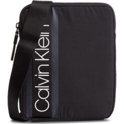 Saszetka CALVIN KLEIN - Clash Flat Crossover K50K504194 001. Czarne saszetki męskie Calvin Klein, z materiału, młodzieżowe. Za 299.00 zł.