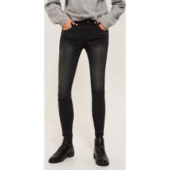 Jeansy skinny - Czarny. Czarne jeansy damskie House. Za 99.99 zł.