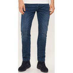 Jeansy slim - Granatowy. Niebieskie jeansy męskie House. Za 99.99 zł.