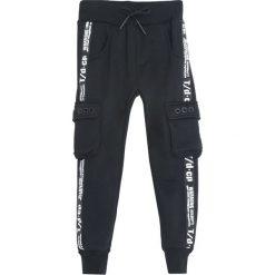 Czarne Spodnie Dresowe Suited Up. Czarne spodnie sportowe dla chłopców Born2be, z dresówki. Za 54.99 zł.