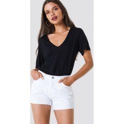 Trendyol Szorty jeansowe z surowym wykończeniem - White. Białe szorty damskie Trendyol, z jeansu. W wyprzedaży za 56.67 zł.