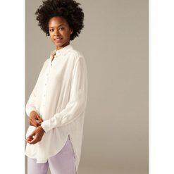 Koszula oversize - Biały. Koszule damskie marki SOLOGNAC. W wyprzedaży za 79.99 zł.