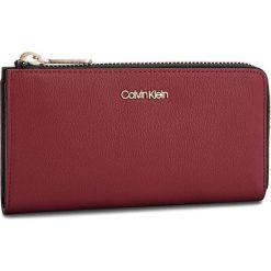 Duży Portfel Damski CALVIN KLEIN - Drive Large Zip Arou K60K604503 628. Czerwone portfele damskie Calvin Klein, ze skóry ekologicznej. Za 299.00 zł.