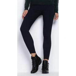 Granatowe Spodnie Across The Line. Niebieskie spodnie materiałowe damskie Born2be. Za 34.99 zł.