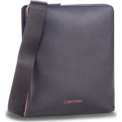 Saszetka CALVIN KLEIN - Double Edge Flat Cro K50K503923 910. Czarne saszetki męskie Calvin Klein, ze skóry ekologicznej, młodzieżowe. Za 349.00 zł.