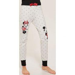 Spodnie piżamowe Disney - Jasny szar. Szare piżamy damskie House, z motywem z bajki. Za 49.99 zł.