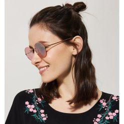 Okulary przeciwsłoneczne - Różowy. Okulary przeciwsłoneczne damskie marki QUECHUA. Za 29.99 zł.