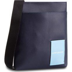 Saszetka CALVIN KLEIN JEANS - Coated Canvas Flat Pack K40K400812 449. Niebieskie saszetki męskie Calvin Klein Jeans, z jeansu, młodzieżowe. Za 349.00 zł.