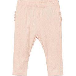 """Spodnie """"Deisse"""" w kolorze brzoskwiniowym. Spodenki niemowlęce marki name it girls. W wyprzedaży za 29.95 zł."""