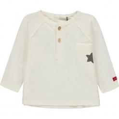 Koszulka w kolorze białym. Białe bluzki dla dziewczynek bellybutton, z bawełny, z okrągłym kołnierzem. W wyprzedaży za 37.95 zł.