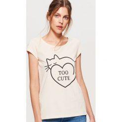 Koszulka z nadrukiem - Kremowy. T-shirty damskie marki DOMYOS. W wyprzedaży za 9.99 zł.