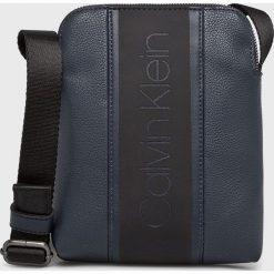 Calvin Klein - Saszetka. Czarne saszetki męskie Calvin Klein, z materiału. Za 299.90 zł.