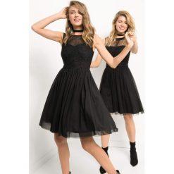 Tiulowa sukienka z brokatem. Czarne sukienki damskie Orsay, z dzianiny, wizytowe, z okrągłym kołnierzem. Za 179.99 zł.