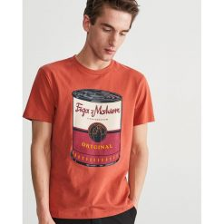 T-shirt z nadrukiem - Pomarańczo. T-shirty damskie marki DOMYOS. Za 39.99 zł.