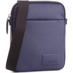 Saszetka CALVIN KLEIN JEANS - Task Force 1 Gusset K50K503854 443. Niebieskie saszetki męskie Calvin Klein Jeans, z jeansu, młodzieżowe. Za 399.00 zł.