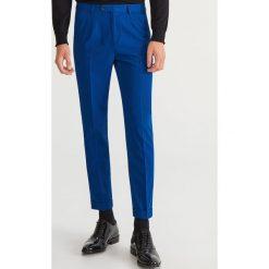 Spodnie garniturowe SUPER SLIM FIT - Niebieski. Eleganckie spodnie męskie marki Giacomo Conti. W wyprzedaży za 89.99 zł.