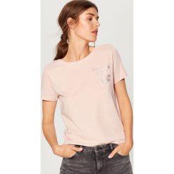Bawełniana koszulka z nadrukiem - Różowy. Bluzki damskie marki DOMYOS. W wyprzedaży za 19.99 zł.