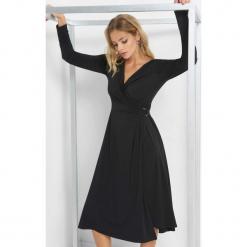 Kopertowa sukienka midi. Czarne sukienki damskie Orsay, z elastanu, wizytowe, z kopertowym dekoltem, z długim rękawem. Za 119.99 zł.