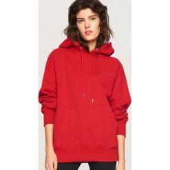Bluza z kapturem - Czerwony. Bluzy damskie marki KALENJI. W wyprzedaży za 69.99 zł.
