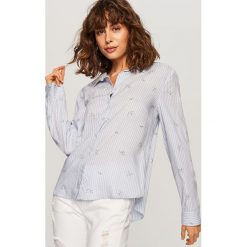 Koszula o klasycznym fasonie - Niebieski. Niebieskie koszule damskie Reserved, klasyczne, z klasycznym kołnierzykiem. Za 59.99 zł.