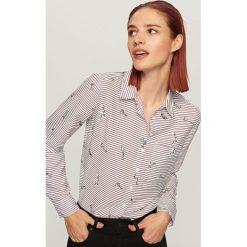 Koszula w paski - Bordowy. Koszule damskie marki SOLOGNAC. W wyprzedaży za 39.99 zł.