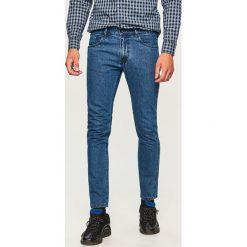 Jeansy slim fit - Niebieski. Niebieskie jeansy męskie Reserved. Za 129.99 zł.