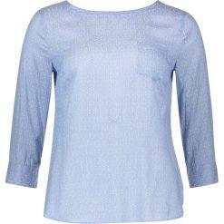 Koszulka w kolorze błękitnym. T-shirty damskie Marc O'Polo Fashion, z dekoltem na plecach. W wyprzedaży za 173.95 zł.