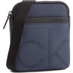 Saszetka CALVIN KLEIN - Ck Point Mini Flat C K50K503875  443. Niebieskie saszetki męskie Calvin Klein, z materiału, młodzieżowe. Za 299.00 zł.