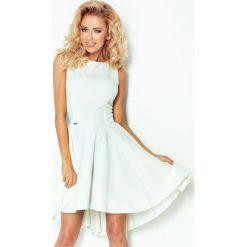 66-7 gruba lacosta - ekskluzywna sukienka z dłuższym tyłem - ecru. Szare sukienki damskie NUMOCO. Za 89.00 zł.