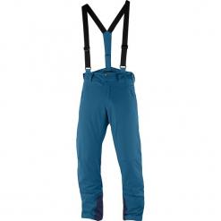 Spodnie narciarskie w kolorze niebieskim. Niebieskie spodnie snowboardowe męskie Salomon, z haftami, z materiału. W wyprzedaży za 500.95 zł.