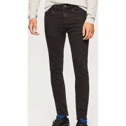 Jeansy slim fit - Czarny. Czarne jeansy męskie Reserved. Za 89.99 zł.
