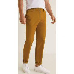 Mango Man - Spodnie Berlin3. Szare eleganckie spodnie męskie Mango Man, z bawełny. W wyprzedaży za 139.90 zł.