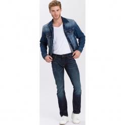 """Dżinsy """"Johnny"""" - Slim fit - w kolorze niebieskim. Niebieskie jeansy męskie Cross Jeans. W wyprzedaży za 136.95 zł."""
