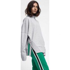 Bluza damska BLD220 - chłodny jasny szary melanż. Bluzy damskie marki KALENJI. W wyprzedaży za 79.99 zł.