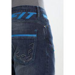 Dynafit Spodnie materiałowe jeans blue. Spodnie materiałowe męskie Dynafit, z bawełny, sportowe. W wyprzedaży za 458.10 zł.